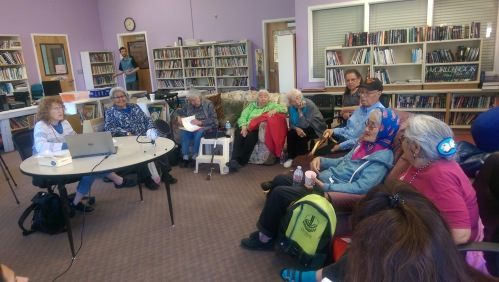 Elders gather in the Holy Cross school library to share language and stories