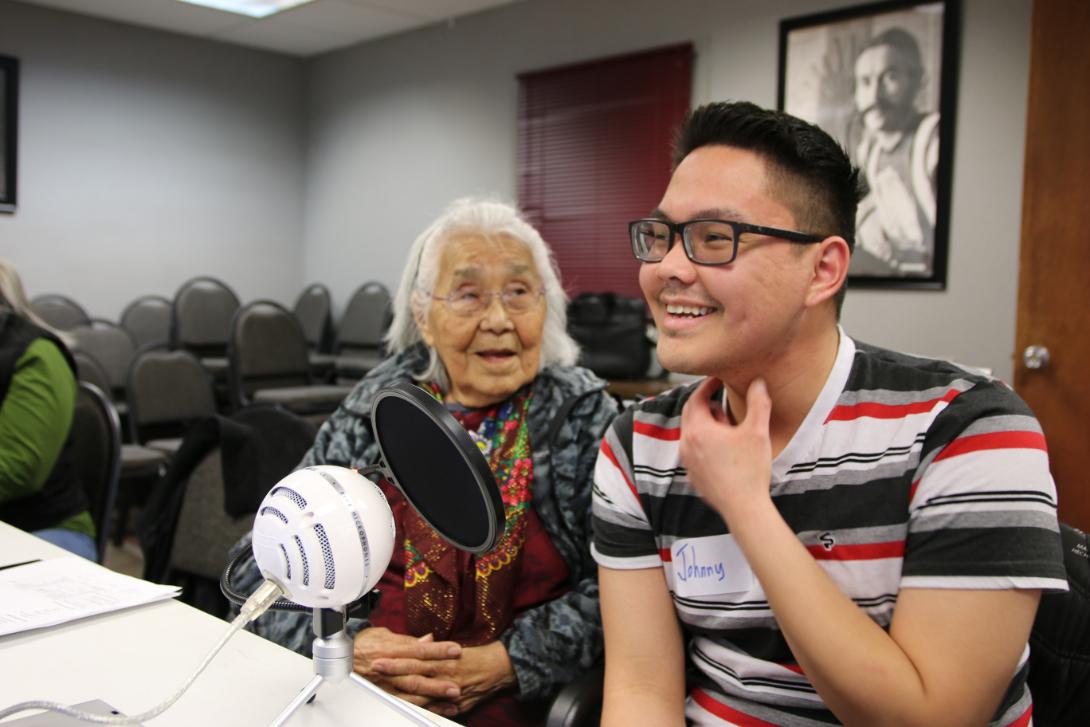 Elder and youth recording Native language translations